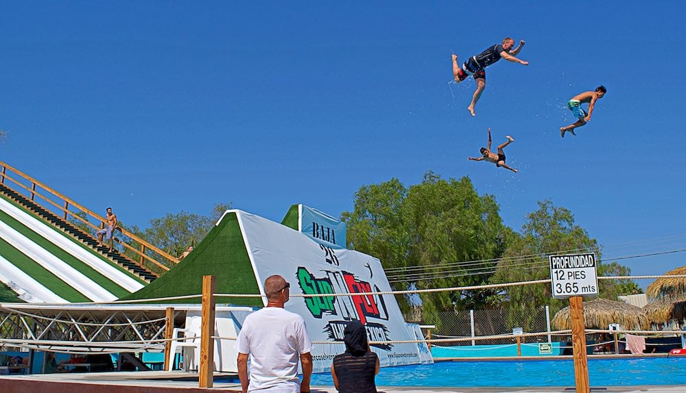 Group flight off the Slip and Fly at Albercas Vergel Tijuana waterpark.